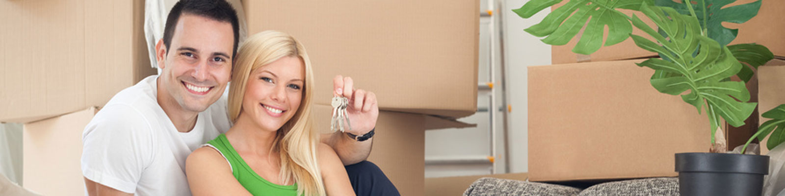 couple move into new home surrounded by boxes